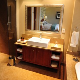 …and a bathroom featuring a wash basin,…