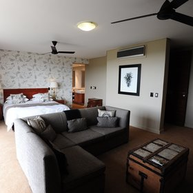 The suite at Sarili Lodge has a larger bedroom hosting a spacious sitting area,…