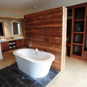 …a bath behind a wooden wall,...
