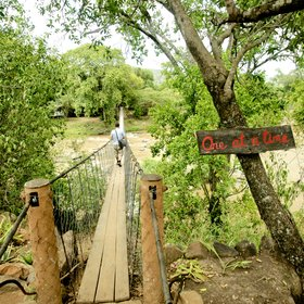 Access to Ngare Serian is via a narrow suspension bridge…