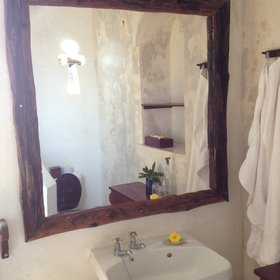 …and you walk along a short passage to reach the bright, en suite bathroom.