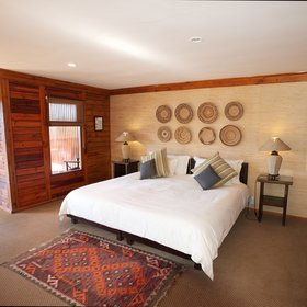 …each of which has a comfortable sitting area and a large bed in the main room.