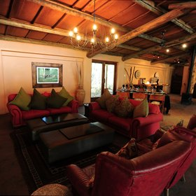 The main area at Ukhozi Lodge includes a lounge…