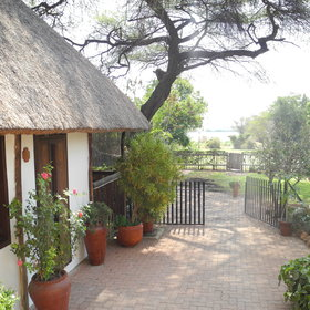 The lodge is located by the river in Kasane, near Chobe National Park.
