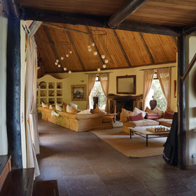 …and from there you descend to a sitting room and fireplace which is best suited to evenings.