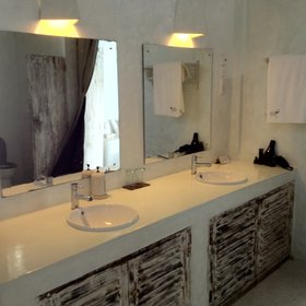 Each bedroom has a bathroom with en-suite wash basins...