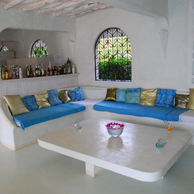 At Msambweni Beach House there is a central bar with an adjoining sitting area...