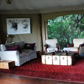 ...where guests can relax with a drink on plush sofas.