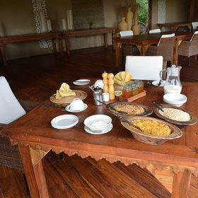 The spread on offer is varied and includes cereals, fruits, and a cooked breakfast.