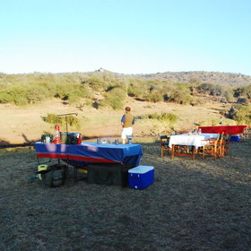 …to camping out, and waking up to breakfast in the bush...