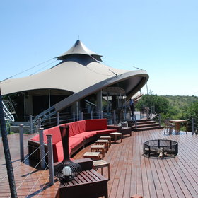 …Mahali Mzuri has a broad deck a fire pit and alfresco dining.