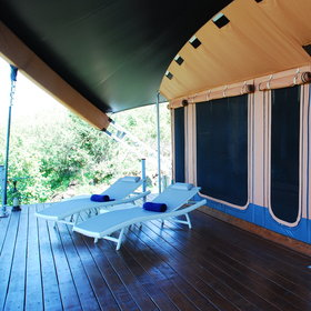 In front is a vast deck which is private and secluded, with loungers….
