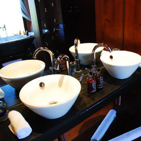 … and twin sinks with toiletries provided.