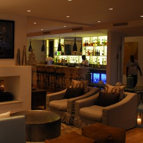 Latitude has a comfortable lounge area, where it's possible to grab a drink from the bar..