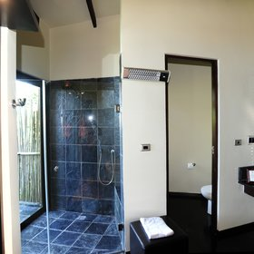 The bathroom comprises an indoor and outdoor shower ...