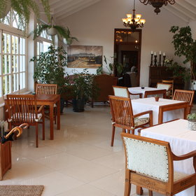Enjoy breakfast in the conservatory-style restaurant...