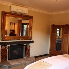 Each room has lovely antique furniture and a fireplace.