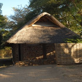 There are four stylish stone and thatch chalets located on the seasonal Kapamba River...