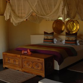 The bedrooms are beautiful, with comfortable beds and large mosquito nets.