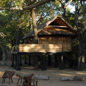 Chamilandu stands beside the Luangwa River, and has three raised chalets.