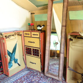a quirky dressing area with old travelling trunks providing storage space, and