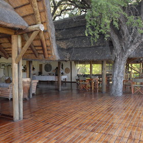 The main area is built on a beautiful wooden deck with an enormous thatched roof