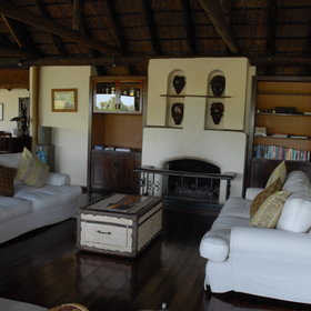 The spacious lounge has a cosy fireplace for the cold months, a small library and...