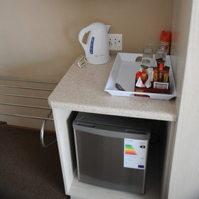 Each room has a fridge and a tea/coffee station…