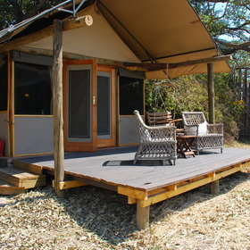 The Busanga Bushcamp accommodates up to eight guests in four pole-and-thatch chalets.