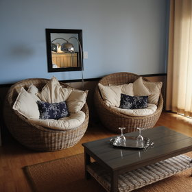 …with a large lounge area, furnished with wicker furniture.