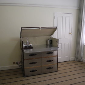Each has a coffee and tea making station in a classic drinks chest...