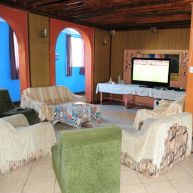…with a lounge area equipped with satellite TV…