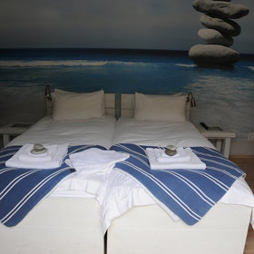 The rooms are spacious and have: white linen sheets…