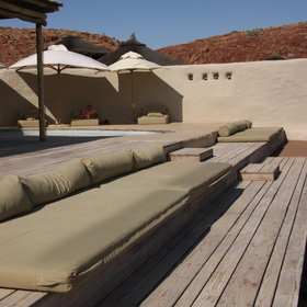 …equipped with shaded sun loungers and huge cushions and pillows...