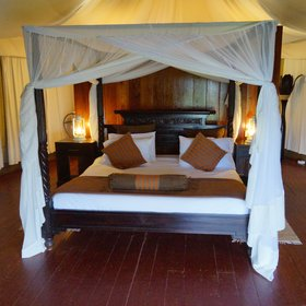 … and either double, twin or triple beds covered by mosquito nets inside.