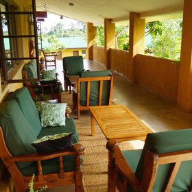 The main area's wooden deck has a comfortable lounge …