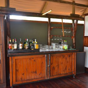 Help yourself to a drink from the bar...