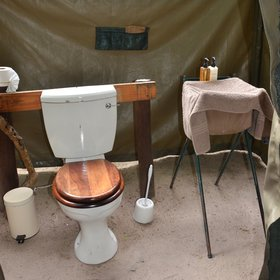 The camp consists of three tents and each of them has a en suite flushing toilet…