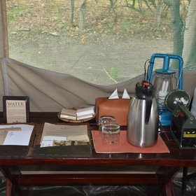The tent includes some basic necessities like solar lantern, water flask, torch and a wardrobe.