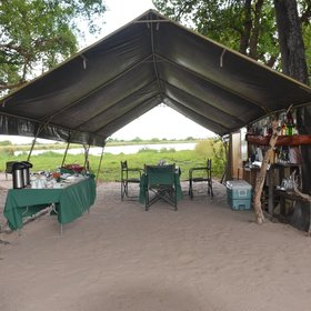 The guests and guide come together under the main tent to enjoy the meals,….