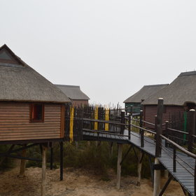 The wooden walkways link the nine high-quality chalets.