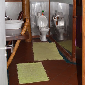 … an en-suite bathroom with a large shower and fluffy towels.