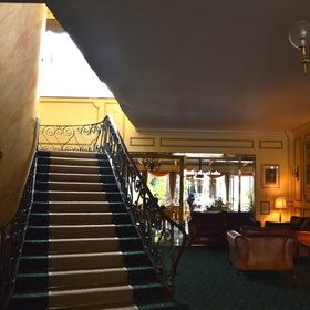 You enter the hotel through a large marble reception area and stairs guide you up to the rooms.