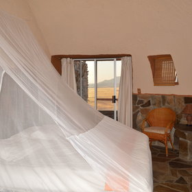 The chalets are simply furnished with a double or twin beds, mosquito nets, a table and two chairs.