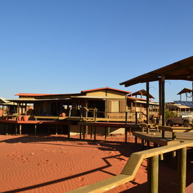 The hub of camp is a collection of wooden-and-canvas rooms, open to the surrounding desert.
