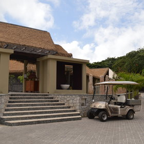 Golf carts ferry guests between the hillside villas and the main areas.