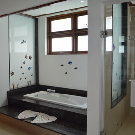 The semi open-plan bathrooms are beautiful and include a bathtub as well as a shower.
