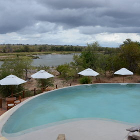 …as well as the large infinity pool of the camp.