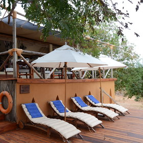 The swimming pool is surrounded by sun loungers to relax between your safari activities.