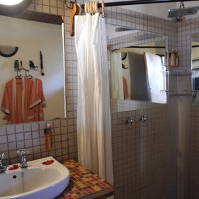 The en-suite bathrooms include a shower and a flushing toilet.